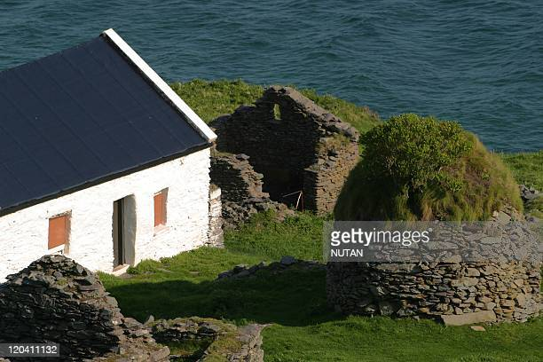 Great Blasket Island Ireland Dunleavy house and the ruins of beehive hut