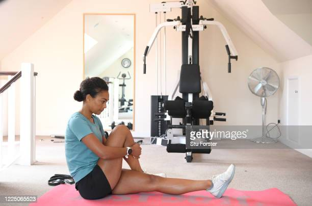 Great Britain 800 metre runner Adelle Tracey stretches before training in rural Gloucestershire on May 15, 2020 in Gloucester, England.