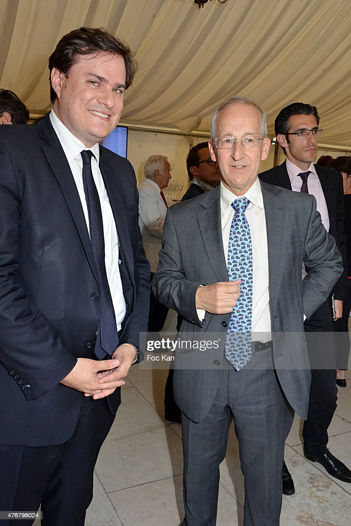 Great Britain ambassador Sir Peter Ricketts (R) and Comite Faubourg Saint Honore President Benjamin Cymerman attend the British 'Summer Time 2015' cocktail at the British Embassy and shops events Rue du Faubourg Saint Honore on June 11, 2015 in Paris, France.