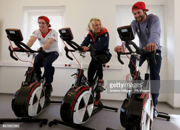 Great Britain Athletes Ben Kilner Aimee Fuller and Billy Morgan on exercise bikes in the Athletes Village