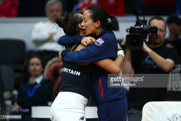 Great Britain Captain Anne Keothavong celebrates with Heather Watson after she wins her singles match against Rebecca Sramkova of Slovakia during the...