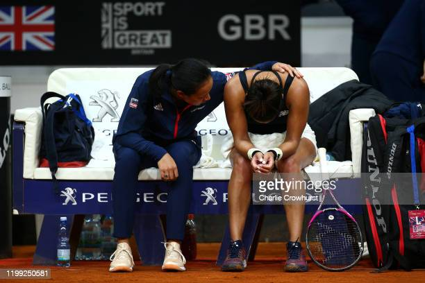 Great Britain Captain Anne Keothavong consoles Heather Watson after she loses singles match against Anna Karolina Schmiedlova of Slovakia during the...