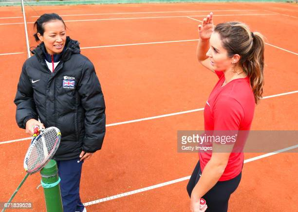 Great Britain captain Anne Keothavong talks with Laura Robson in a warm up during day 2 of the Fed Cup World Group II Play Off between Romania and...