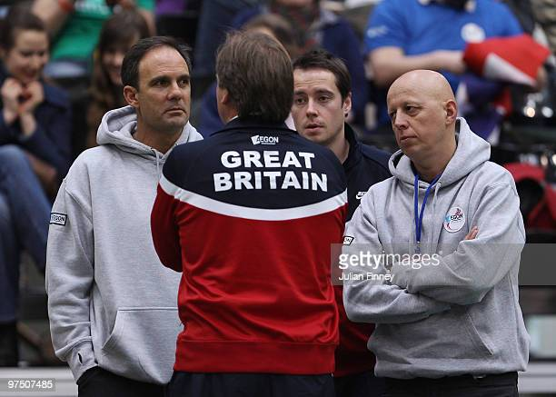 Great Britain captain John Lloyd speaks with LTA coach Paul Annacone physio Rob Hill and player director Steve Martens after James Ward of Great...