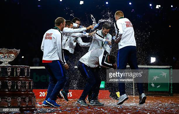 Great Britain Captain Leon Smith is drenched with water by his players following his team's victory during day three of the Davis Cup Final match...