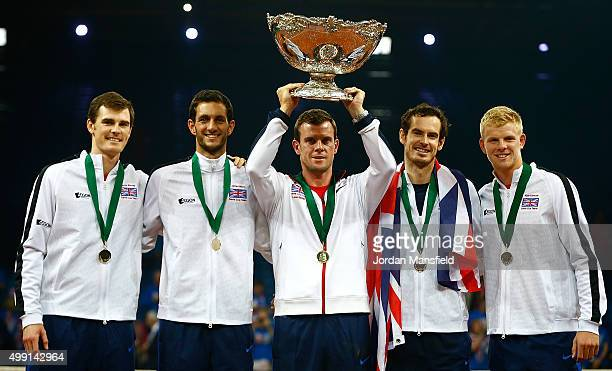 Great Britain Captain Leon Smith lifts the trophy with his team Jamie Murray James Ward Andy Murray and Kyle Edmund following their victory during...