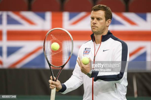 Great Britain captain Leon Smith passes a ball during a doubles practice session prior to the Davis Cup World Group tie between Great Britain and...