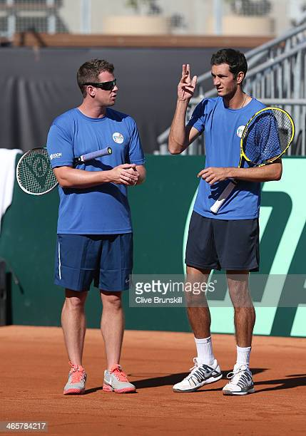 Great Britain captain Leon Smith talks with James Ward during a practice session prior to the Davis Cup World Group first round between the U.S. And...