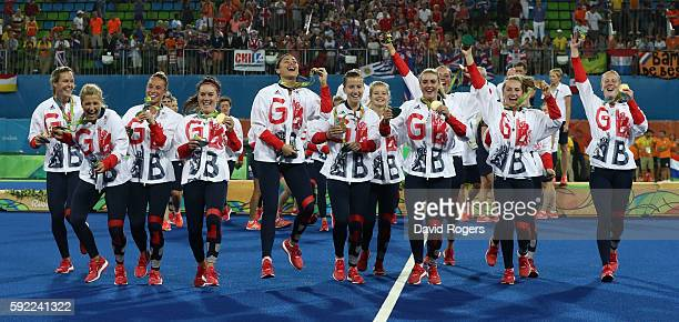 Great Britain celebrate after winning the Gold medal match on penalties against the Netherlands during the Women's hockey Gold medal match between...