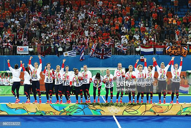 Great Britain celebrate on the podium after winning a penalty shoot out during the Women's Hockey final between Great Britain and the Netherlands on...