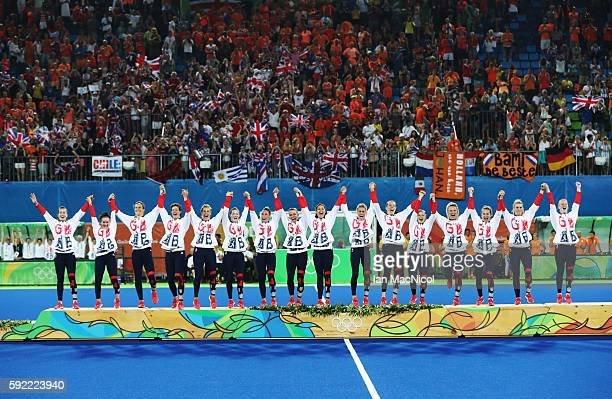 Great Britain celebrates on the podium after winning a penalty shoot out during the Women's Hockey final between Great Britain and the Netherlands on...