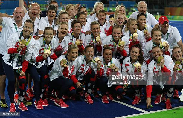 Great Britain celebrates with their medals after winning a penalty shoot out during the Women's Hockey final between Great Britain and the...
