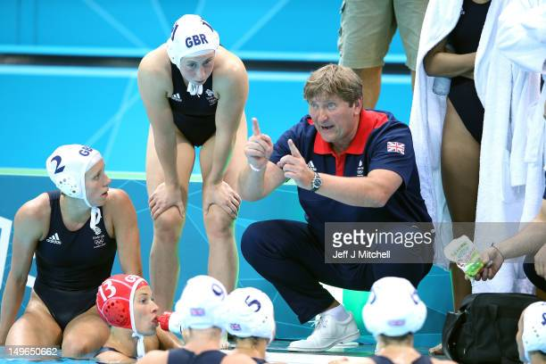 Great Britain coach Szilveszter Fekete speaks to his players in the Women's Preliminary Round Water Polo match between Great Britain and Australia on...