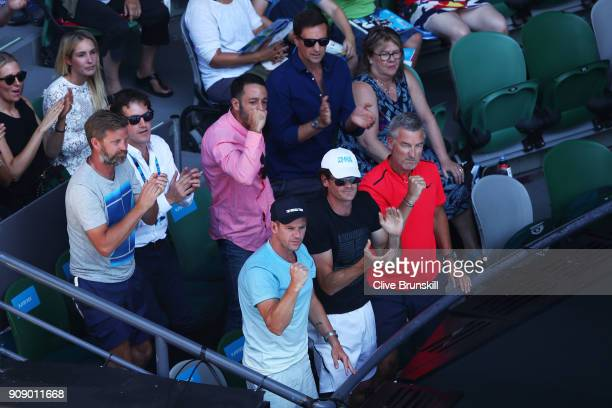 Great Britain Davis Cup team captain Leon Smith and Edmund's coach Fredrik Rosengren cheer on Kyle Edmund of Great Britain from the player's box in...