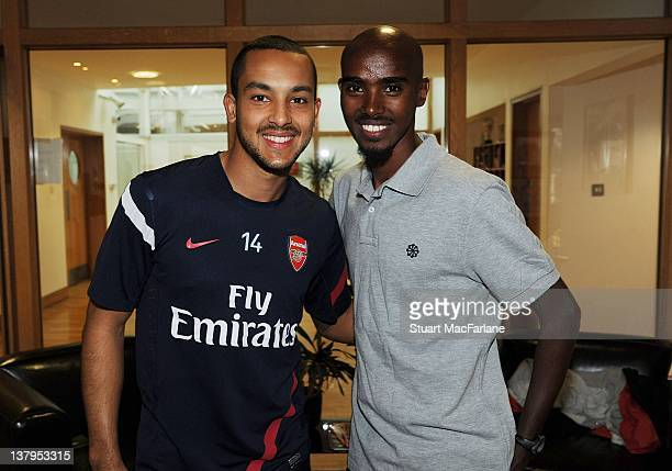 Great Britain distance runner Mo Farah meets Theo Walcott of Arsenal before a training session with the Arsenal football team at London Colney on...
