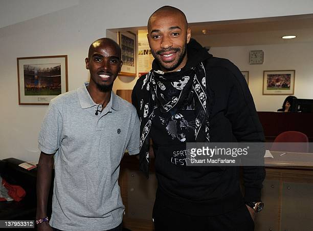 Great Britain distance runner Mo Farah meets Thierry Henry of Arsenal before a training session with the Arsenal football team at London Colney on...