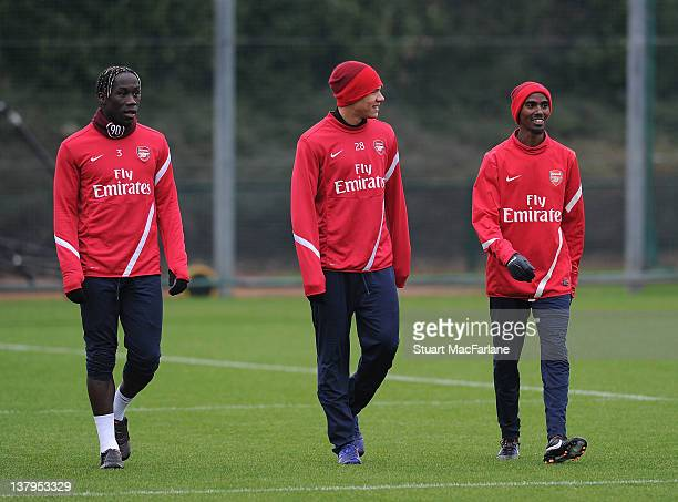 Great Britain distance runner Mo Farah with Kieran Gibbs and Bacary Sagna of Arsenal during a training session with the Arsenal football team at...