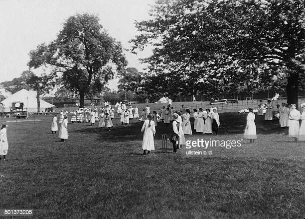 employees of the Cadbury confectionary company in Bourneville near Birmingham have a rest in the companyowned park probably in the 1910s
