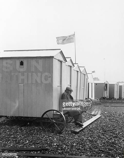 Great Britain England Brighton Beach pictures Misty wheather in Brighton changing cubicles at the beach 1931 Photographer James E Abbe Vintage...