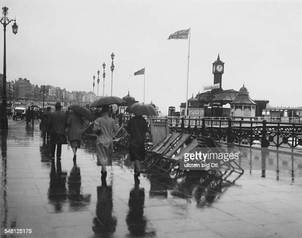 Great Britain England Brighton The promenade and the entrance to the Brighton Pier in bad weather 1931 Photographer James E Abbe Vintage property of...