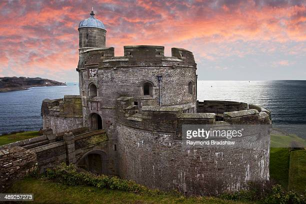Great Britain, England, Cornwall, St Mawes Castle on coastline near Falmouth at sunset.
