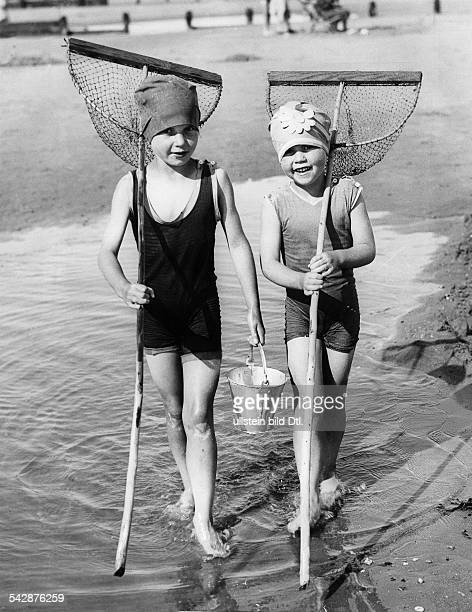 Great Britain England Ipswich: Beach pictures Clacton-on-Sea: two children with dip nets and a bucket at the beach - 1929 - Photographer: Max...
