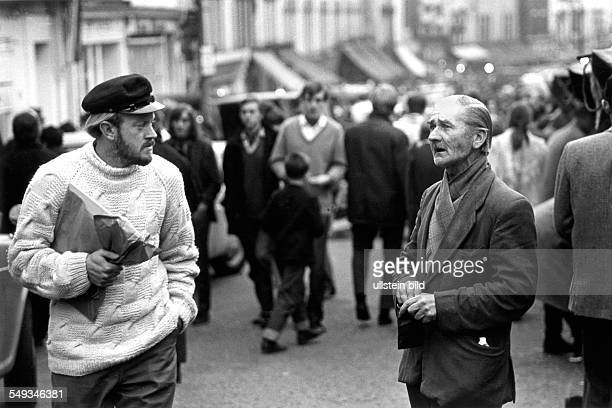 Great Britain England London beggar singing on the street in Portobello Road