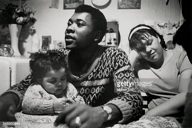 Great Britain, England, London, black man and white woman, mixed married couple with child.