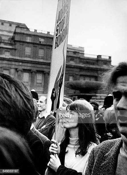 Great Britain England London demonstration against Vietnamwar on Trafalgar Square young woman with transparent 'Stop the Bombing'