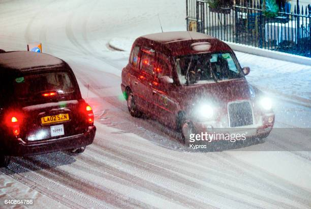 UK, Great Britain, England, London, Paddington, View Of Taxi's Driving In Snow