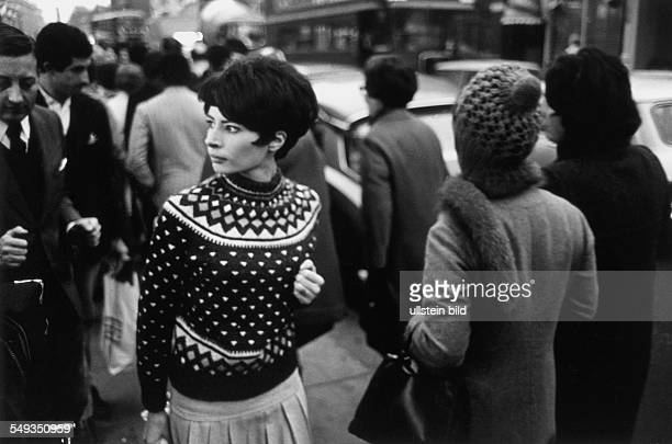 Great Britain England London streetscene with young woman in the crowd of rushhours on the street