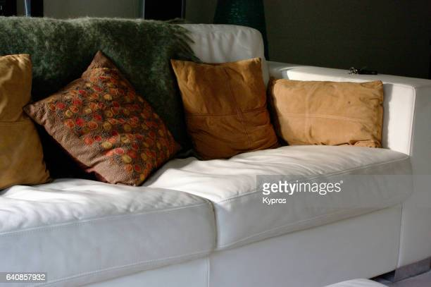 uk, great britain, england, london, view of custom furniture, hand-made white leather couch or sofa with cushions - cushion stock photos and pictures