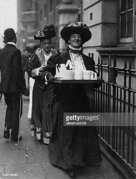 Great Britain England London Women's rights activists Miss Cecily Moloney bringing tea for the imprisoned 'sisters' and other prisoners in...