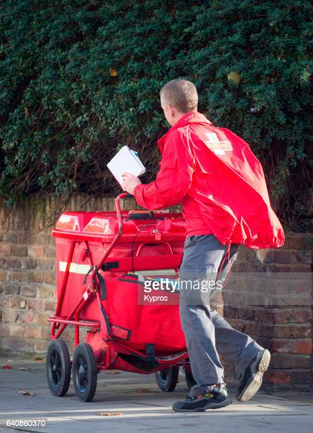 UK, Great Britain, England, View Of Postman Delivering Mail