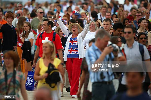 Great Britain fan cheers as she walks through a crowd outside the Olympic stadium during the Olympics Opening Day as part of the London 2012 Olympic...