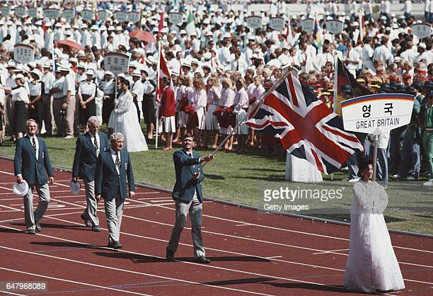 Great Britain hockey goalkeeper Ian Taylor carries the national flag ahead of team Great Britain into the Olympic Stadium during the Opening Ceremony...