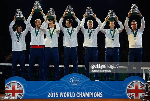 Great Britain lift their trophies following their victory during day three of the Davis Cup Final match between Belgium and Great Britain at Flanders...