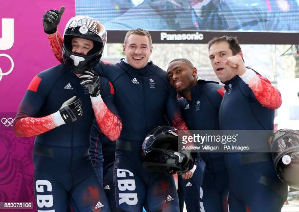 Great Britain Men's Bobsleigh GBR1 Team of Stuart Benson Bruce Tasker Joel Fearon and John Jackson celebrate after their fourth run at the Sanki...