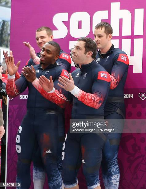 Great Britain Men's Bobsleigh GBR1 Team of Stuart Benson Joel Fearon John Jackson and Bruce Tasker celebrate after their fourth run at the Sanki...