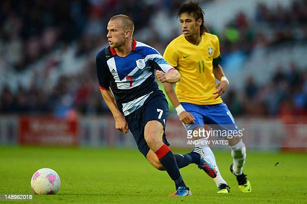 Great Britain midfielder Tom Cleverley vies for the ball with Brazilian forward Neymar during the London 2012 Olympic games warm up football match...