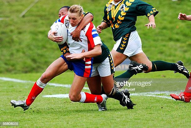 Great Britain No1 Nicky Simpson gets tackled by the Cook Island defence during the 2002 Womens Rugby League World Cup between Great Britain and Cook...