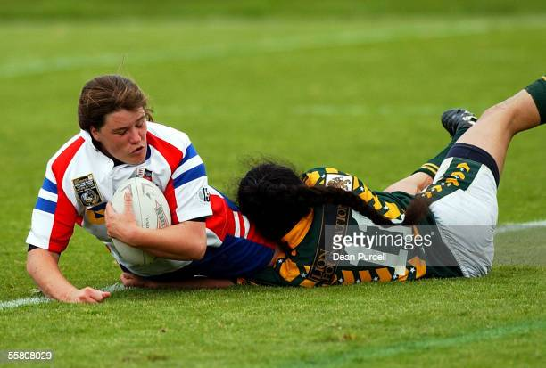 Great Britain No24 Michelle Wood is tackled by Cook Island No11 Tracey Larkin during the 2002 Womens Rugby League World Cup between Great Britain and...