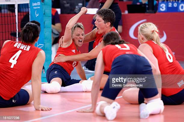 Great Britain players celebrate during the Women's Sitting Volleyball Preliminaries Pool A match between Great Britain and Ukraine on day 2 of the...