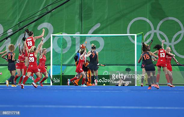 Great Britain players celebrate the third goal scored by Nicola White during the Women's Gold Medal Match against the Netherlands on Day 14 of the...