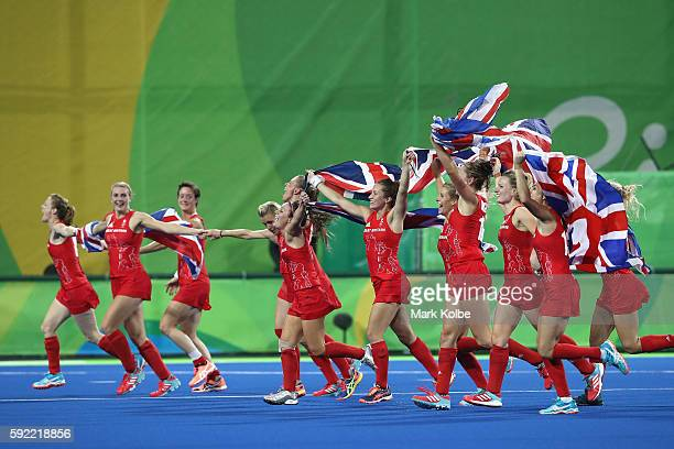 Great Britain players celebrate winning against Netherlands to win the Women's Gold Medal Match on Day 14 of the Rio 2016 Olympic Games at the...