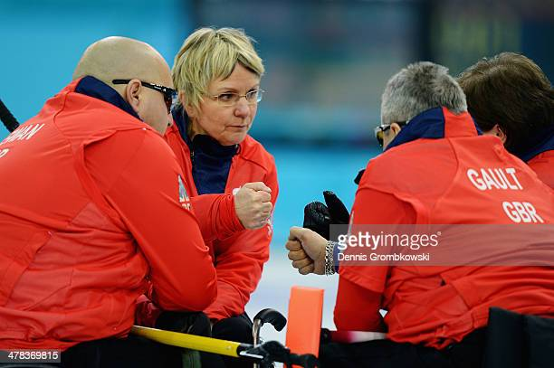 Great Britain players come together during the Wheelchair Curling Round Robin Session 11 during day six of Sochi 2014 Winter Paralympic Games at Ice...