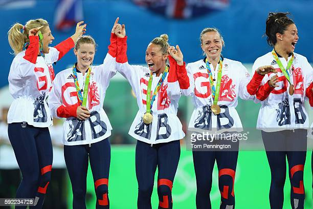Great Britain players Georgie Twigg Helen RichardsonWalsh Susannah Townsend Kate RichardsonWalsh and Sam Quek react with their gold medals after...