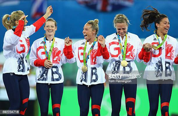 Great Britain players react with their gold medals after defeating Netherlands in the Women's Gold Medal Match on Day 14 of the Rio 2016 Olympic...
