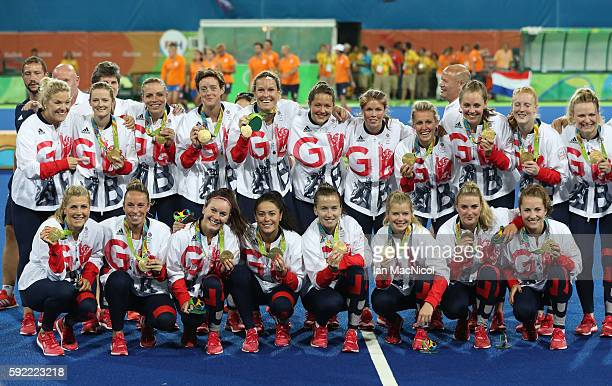 Great Britain pose after winning a penalty shoot out during the Women's Hockey final between Great Britain and the Netherlands on day 14 at Olympic...