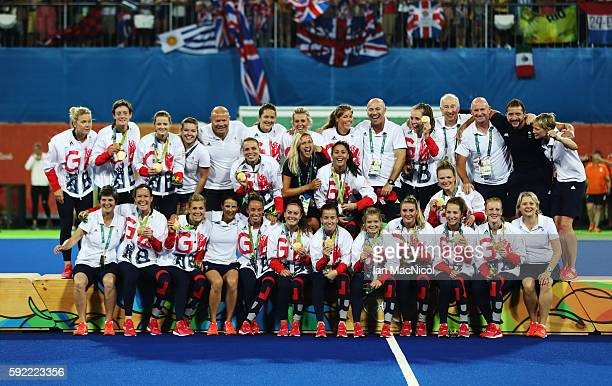 Great Britain pose on the podium after winning a penalty shoot out during the Women's Hockey final between Great Britain and the Netherlands on day...